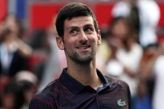 Novak Djokovic celebrates victory over Australia's Alexei Popyrin.