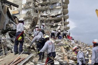 Search-and-rescue teams sift through the rubble of the collapsed apartment building in Miami on Friday, local time.