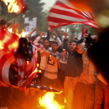 Iranian demonstrators burn representations of the US flag during a protest in front of the former US Embassy after Donald Trump pulled the US out of the nuclear deal.