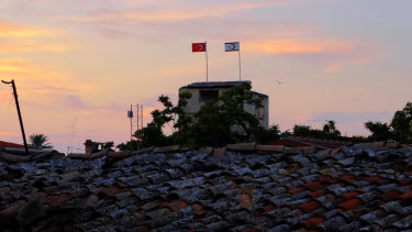 A Turkish military guard post with Turkish, left, and Turkish Cypriot breakaway flags on the polls is seen at the Turkish Cypriot controlled area at the north part of the divided capital Nicosia, Cyprus,