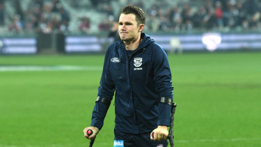 Patrick Dangerfield walks off the field on crutches.