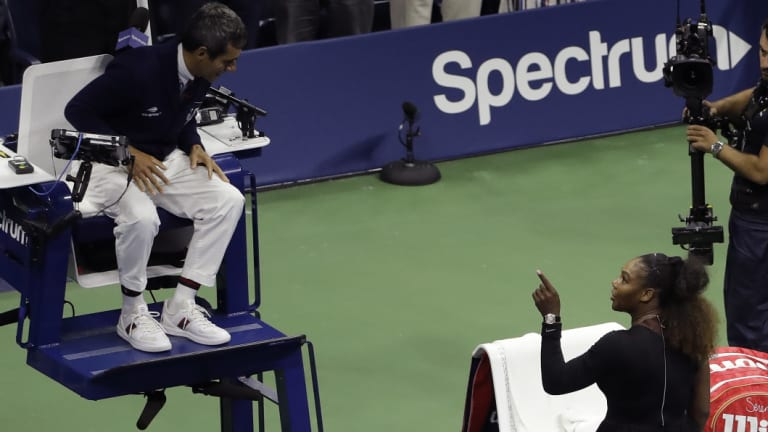 Livid: Serena Williams berates chair umpire Carlos Ramos for issuing her with code violations.