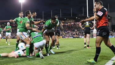 The Raiders celebrate a John Bateman try late in their thrilling win over the Panthers.