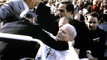 Pope John Paul lies wounded in St. Peter's Square after the assassination attempt.