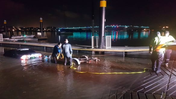 Man watches BMW slide down boat ramp, sink in Brisbane River after trying to retrieve jet ski