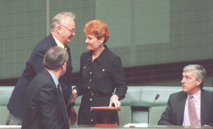 Independent MP Pauline Hanson is congratulated after her maiden speech by fellow Independents  Graeme Campbell (left) Allan Roacher (front) and Peter Andren (right).