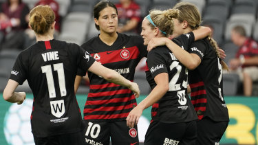 Western Sydney celebrate after Kristen Hamilton's effort was turned into the net by a Glory defender to clinch their 3-1 win.
