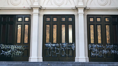 Graffiti on ceremonial front doors of the southern entrance of the Royal Exhibition Building.