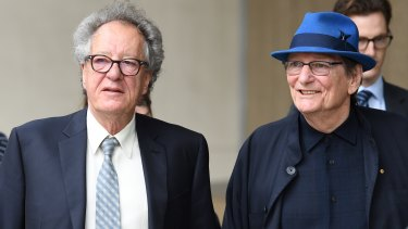 Geoffrey Rush and Fred Schepisi outside the Federal Court on Friday.