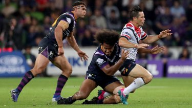 No love lost: Cooper Cronk tackled by Felise Kaufusi on Friday.