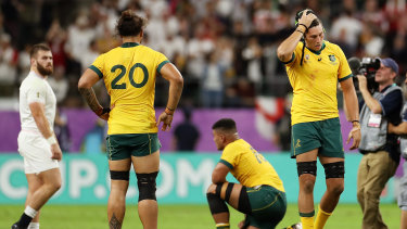 All over: The Wallabies take in defeat.