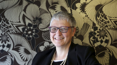 Commonwealth Bank group executive human resources Sian Lewis had to get to university before she could take up cricket and rugby. She has long hung up her bat and boots but is still a fierce advocate for women's sports.