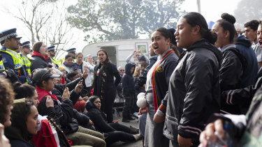 Secondary school students perform a haka at the  Ihumatao protest site.