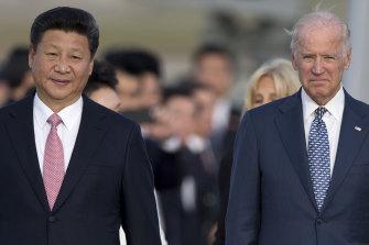 Xi Jinping and Joe Biden in 2015.