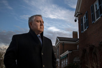 "Joe Hockey, pictured outside the Australian ambassador's residence in Washington in January 2020, has been talking up the ""Australian model"" in DC's corridors of power."