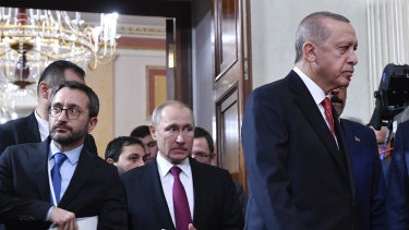 Erdogan, right, and Putin, middle, are jockeying for clout in Syria.