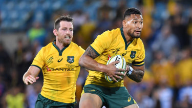 Delayed: Bernard Foley (left) said the Wallabies shouldn't require a spray to produce their best.