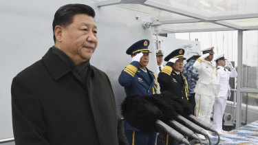 Chinese President Xi Jinping reviews a naval parade with Chinese and foreign military ships last month.