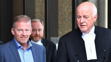 Chris Oliver (left) and Stuart Littlemore QC (right) leave the Federal Court in Sydney on Monday.