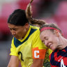 Sam Kerr and Becky Sauerbrunn compete for the ball.