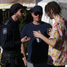 A police sniffer dog squad speak to a festival goer at Splendour in the Grass this year.