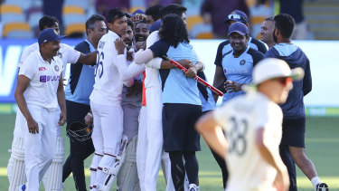 Indian players celebrate after defeating Australia by three wickets on the final day of the fourth Test.