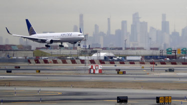 A United Airlines jet prepares to land at Newark Liberty International Airport a day after a temporary grounding of aircraft was placed after reports of drones in the flight path.