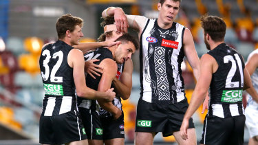 Former Pie Flynn Appleby (centre) has been cut by North Melbourne.