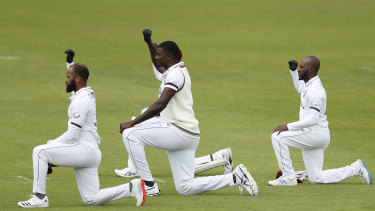 West Indies' captain Jasion Holder, centre, and teammates take a knee before the start of the Test match between England and West Indies at Southampton.