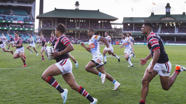 Unstoppable: Mitchell heads to the try line against the Titans at the SCG.