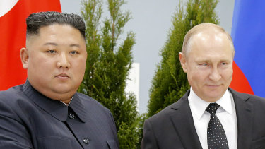 Russian President Vladimir Putin, right, and North Korea's leader Kim Jong-un shake hands during their meeting in Vladivostok, Russia.