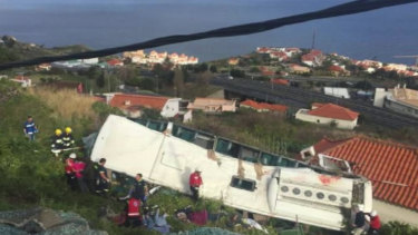 Emergency services attend the scene after a tour bus crashed at Canico on Portugal's Madeira Island.