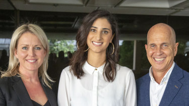 Lamisse Hamouda, daughter of Hazem Hamouda is seen posing for photograph alongside journalist Peter Greste (right) and her family's lawyer Jennifer Robinson(left) at Queensland Parliament House in Brisbane on Thursday.