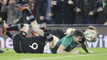 Ireland's Jacob Stockdale scores against the All Blacks in November.