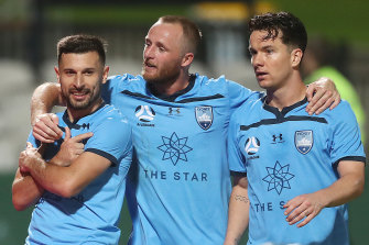 Kosta Barbarouses (left) celebrates his goal with Rhyan Grant and Alexander Baumjohann.