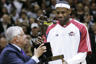 Stern presents LeBron James with the NBA's MVP trophy in 2009.