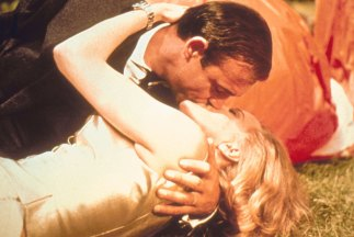 Sean Connery as James Bond and Honor Blackman as Pussy galore in Goldfinger.