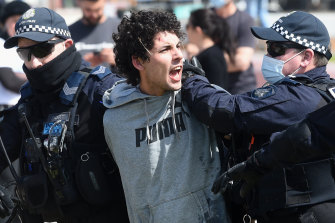 Police arrest a demonstrator on Saturday.