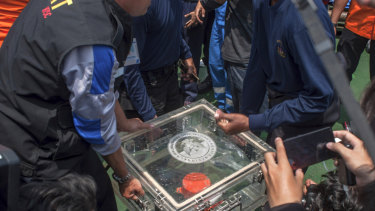 The box containing flight data is carried ashore on Thursday.