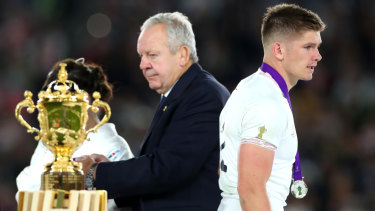 Flattered to deceive: Owen Farrell walks off the stage after receiving his silver medal as the Webb Ellis Cup goes in the other direction.