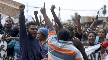 Papuans shout slogans during a protest in Timika, Papua province.