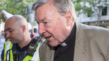 Cardinal George Pell arrives at Melbourne Magistrates Court on Wednesday.