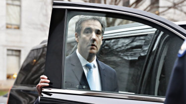 Cohen leaves the committee after testifying.