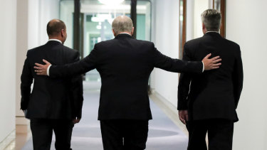 Job done: Treasurer Josh Frydenberg, Prime Minister Scott Morrison and Minister for Finance Mathias Cormann leave the press conference held after passing the government's tax cuts.