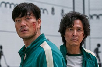Lee Jung-jae, right, in Squid Game with co-star Park Hae-soo.