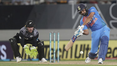 Heave: India's Rohit Sharma advances down the pitch.