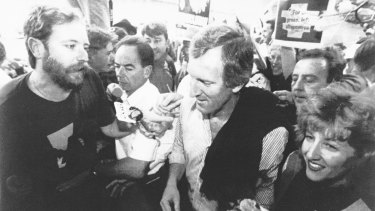 Security struggle to keep a protester from accosting John Hewson during his visit to Hobart's Salamanca Market on February 21, 1993.