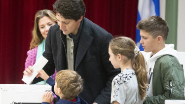 Canadian Prime Minister Justin Trudeau casts his ballot surrounded by his family in Montreal last year.