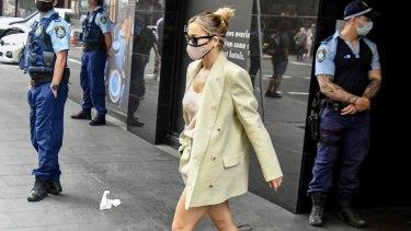 Rita Ora leaves hotel quarantine at the Meriton Suites on Sussex Street.