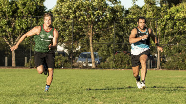 Toby Rudolph  trains with housemate Liam Knight during the COVID lockdown.